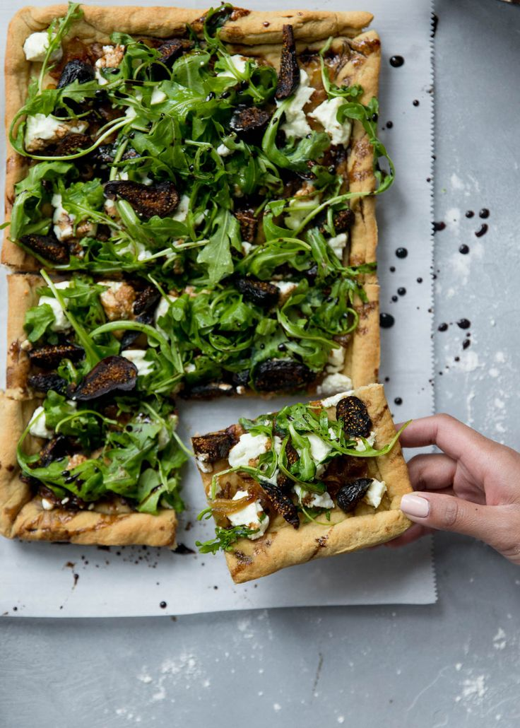 Amazing fig and goat cheese pizza with caramelized onion, goat cheese and an easy homemade 100% whole wheat pizza dough. Everyone loves this recipe!
