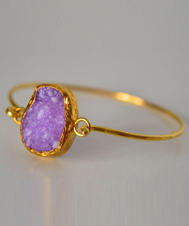 Anilo piedra lila engarzado en oro