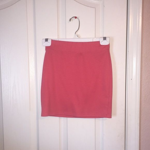 Coral pencil skirt Very pretty coral, tight pencil skirt. Fits perfectly. In good condition. Nollie Skirts Pencil