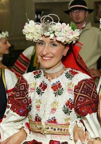 Woman in centre wears costume from village Polomka (Horehronie region, Central Slovakia), other girls wear costumes from village Vrbov (Spiš region, Eastern Slovakia).