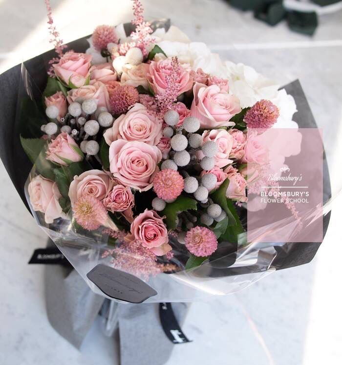 Hand-tied with pink roses and white hydrangea from Bloomsbury's flower school
