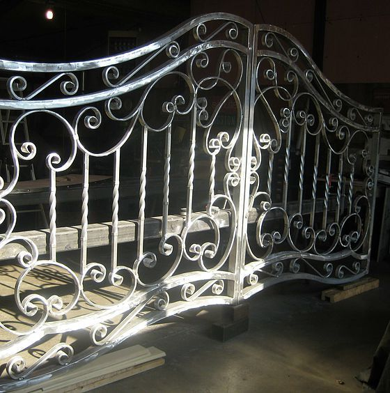 German Blacksmith located west of Chicago, specializes in Custom Driveway Gates and Ornamental Iron.