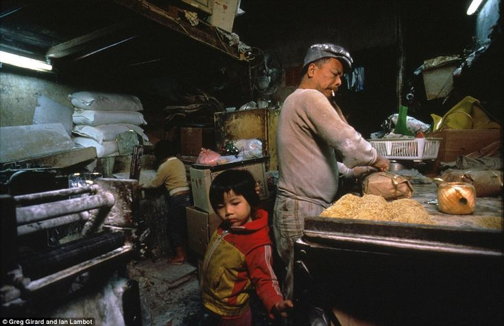 Kowloon Walled City - Greg Girard and Ian Lambot - A workplace during the day would turn into a living room at night when Hui Tung Choy's wife and two young daughters joined him at his noodle business. The children would play and do homework on a four-covered work bench.