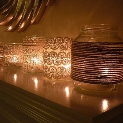 Centerpieces/Votives- mason jars with lace and candles