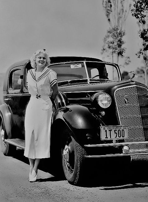 Jean Harlow, by her nice car.