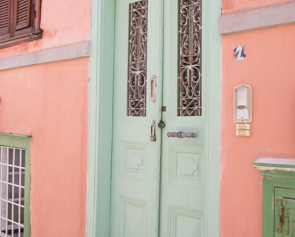 coral & green house in Syros, Greece
