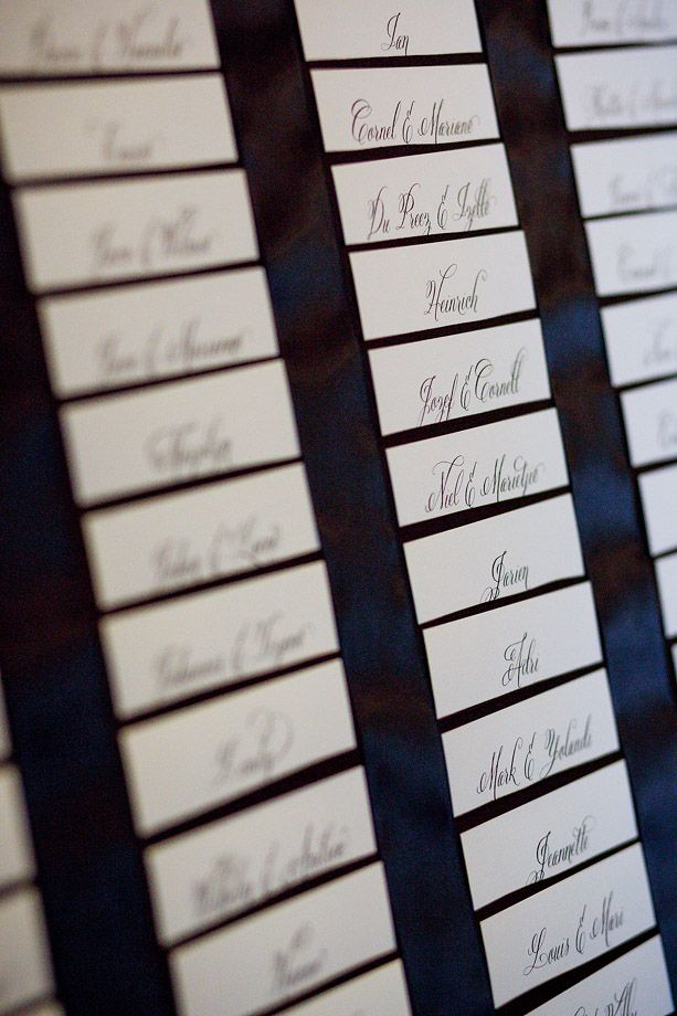 Table plan consist of individual white cards nested in black double-satin ribbon board.(photography: janib.co.za)