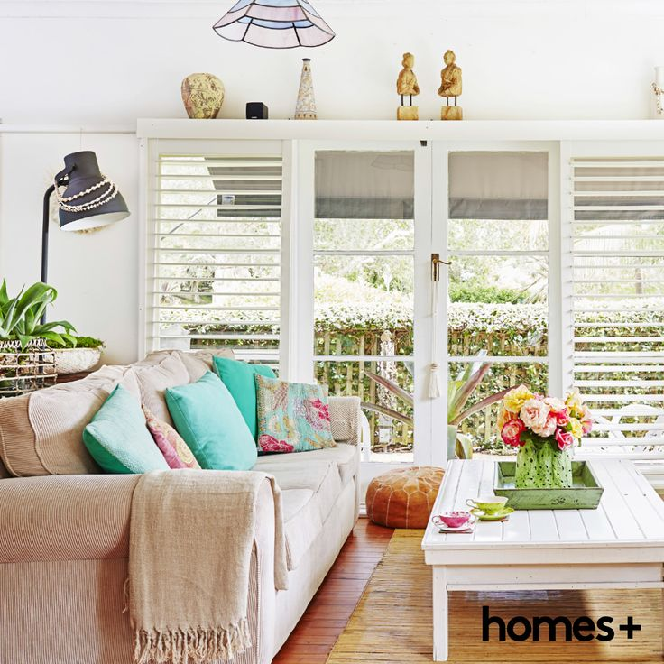 Reader Di has decorated her #home in a lovely casual and breezy #coastal style. As featured in the June 2015 issue of homes+. #readerhome #beach #house #plantation #shutters #frenchdoors #livingroom