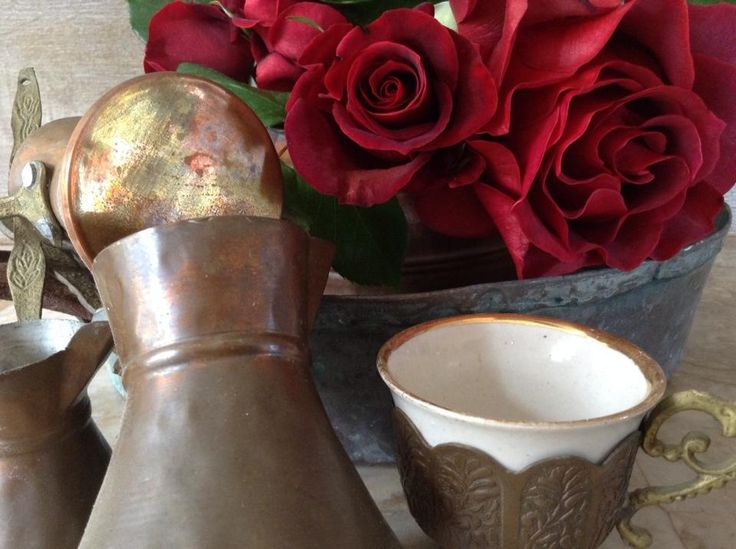roses in old copper pan