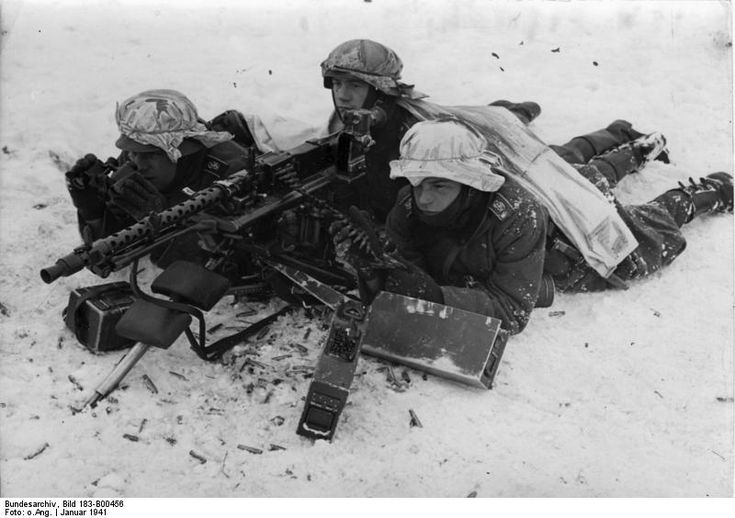 German MG34 machine gun crew in wintry terrain, Jan 1941.