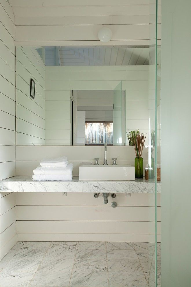 "martin gomez architectos add waterfall side and 12"" privacy ledge next to toilet.  teak slat-wood shelf w/baskets underneath"