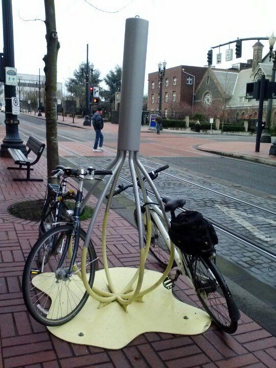Bike rack outside of a cupcake shop