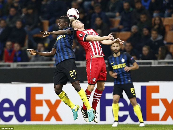 Inter Milan's Assane Demoya Gnoukouri attempts to beat Southampton midfielderJames Ward-Prowse to the header