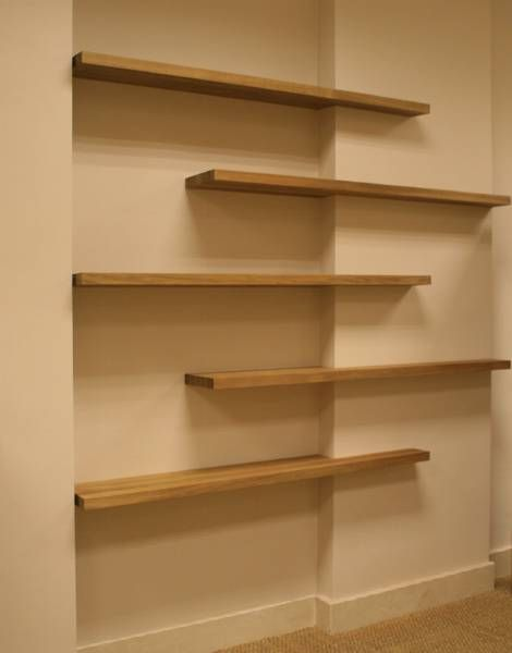 This is how the shelves would be installed on a flat wall: offset, but in line with each other.