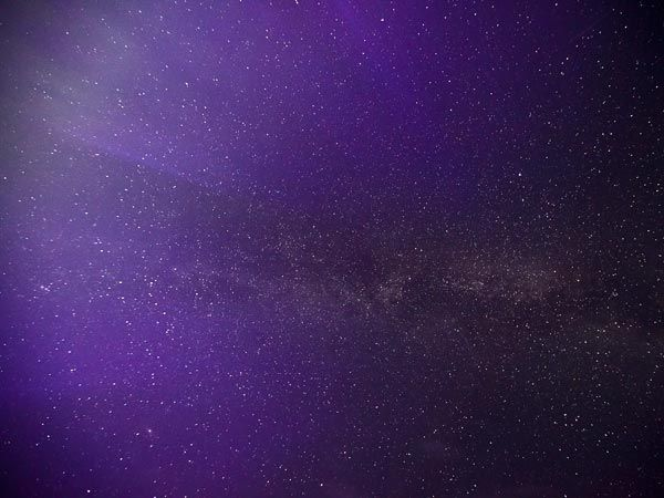 """Galactic Haze. Photograph courtesy Shawn Stockman-Malone - """"Deep purple light seems to bathe the Milky Way, as seen in a picture snapped in northern Michigan (july 8 2012)) early Sunday morning. Often auroras can be as faint as starlight, which can make them invisible near cities with light pollution. To see fainter sky shows, space-weather experts suggest heading toward the countryside and facing the northern horizon near local midnight, when skies are darkest.""""Outter Spaces, Purple Lights, Northern Lights, Beautiful Sky, Rare Colors, Purple Stars, Sky Pictures"""