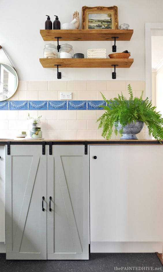 DIY Budget Laundry Makeover with sliding barn doors. Use these for our built-ins?