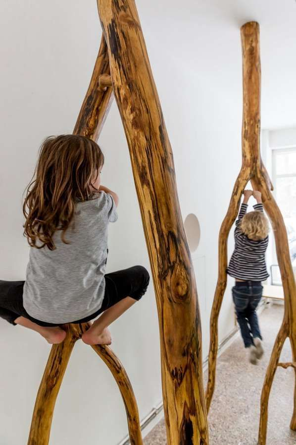 I love how children are encouraged to climb and play in this image. I am also drawn to the rich timber tones against the white wall paint. They look like they're having so much fun!