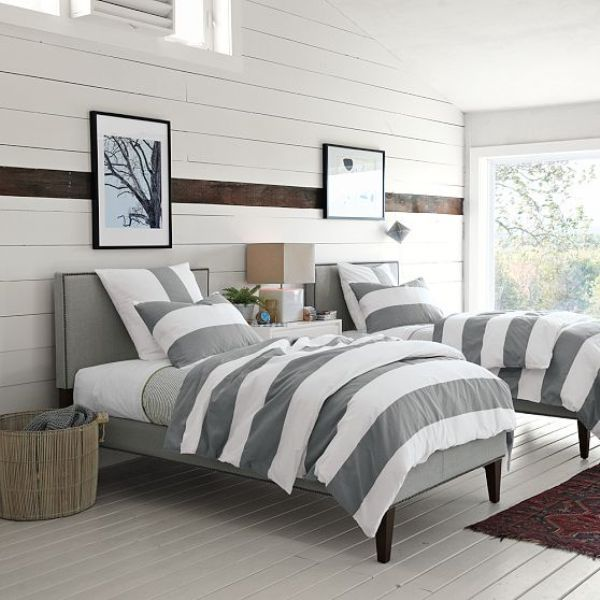 LOVE the stained stripe on the wall of painted white planks! Gorgeous white painted floors and crisp tailored bed and bedding