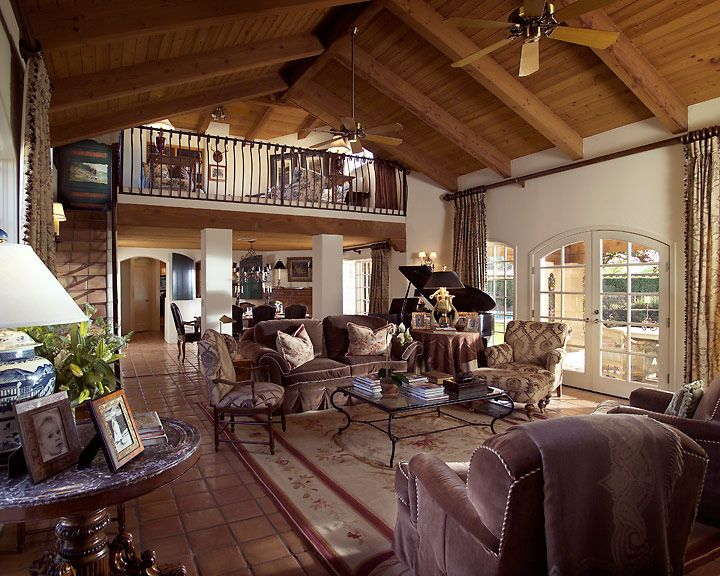 This Santa Barbara style great room is a classic inspired room with a strie  chocolate velvet