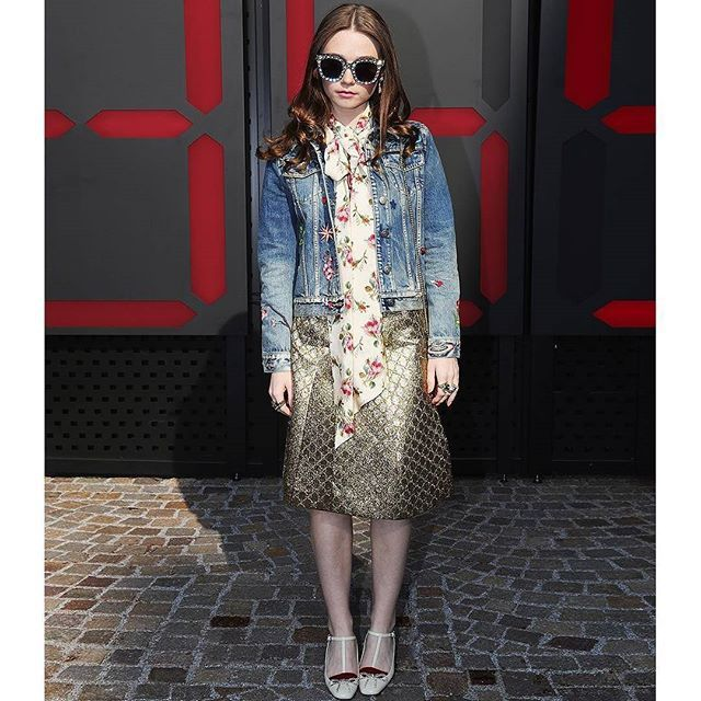 #Repost @gucci (@get_repost)  @jessybarden who took over Guccis Instagram Stories for the #GucciFW18 show now in  Gucci Instagram Highlights in a Gucci embroidered denim jacket with a silk rose printed blouse iridescent GG lurex pleated skirt pumps with crystal bow detail and #GucciSylvie mini chain bag. She completed her look with crystal studded sunglasses and rings in aged metal.  #AlessandroMichele #mfw #GucciEyewear