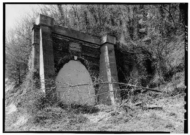 Blue Ridge Railroad, Greenwood Tunnel, Greenwood, VA 1853 The Greenwood Tunnel was the easternmost of the four tunnels designed by Claudius Crozet for the Blue Ridge Railroad. The brick, elliptical arched tunnel is a representative example of 19th century tunnel technology, as well as a surviving example of the work of Claudius Crozet. / The Blue Ridge Railroad, 17 miles in length, originally connected the terminus of the Louisa Railroad near Blair Park with the town of Waynesboro.