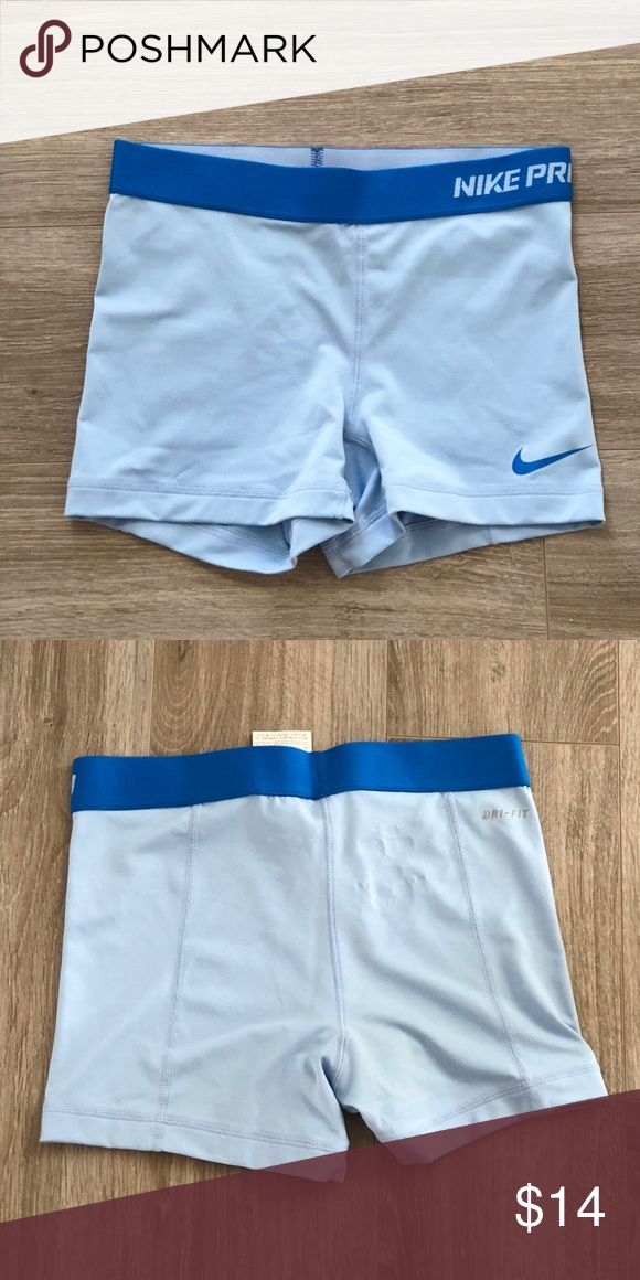 "Nike Pro Women's 3"" Training Compression Shorts Dri-Fit material. 3"" inseam. Machine washable. Good used condition. Snug and comfortable fit.   Body: 82% polyester, 18% spandex Gusset Lining: 100% polyester Nike Shorts"