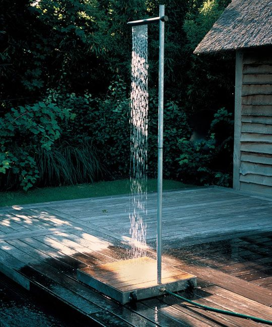 "Minimalist Outdoor Shower From Atelier Tradewinds: ""The acacia wood frame is set on a couple of nylon gliders so that the shower can easily be moved. The shower tube itself is made of galvanized steel; a simple tap attached to the tube regulates the water pressure."""