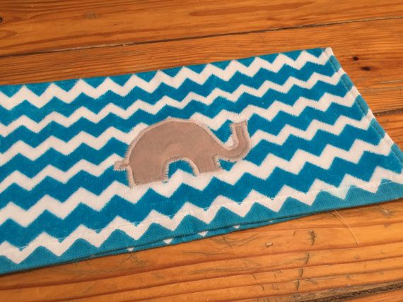 A very soft microfiber blue chevron towel with a grey elephant embroidered on it. Great for a burp cloth or a wonderful hand towel.  Very limited quantities so get it while you can!  If you would like a specific color scheme feel free to ask me, I can see what I can make for you