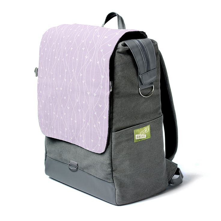 The Laine Avenue Convertible Backpack in the new sweethearts pattern, shown in Lavendar. This is the only backpack with a flap that instantly removes to become a purse! That's why we call it the convertible. Not as cool as a car, but pretty cool.