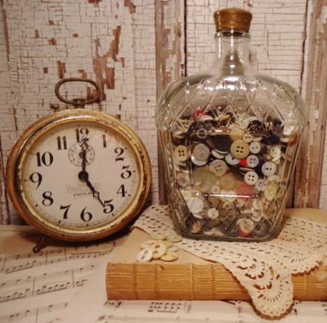 Vintage clock & buttons in a Crown Royal bottle