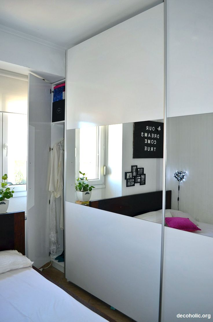 Small tiny bedroom with large fitted sliding wardrobe and fairy lights.