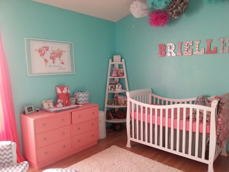 Coral pink and teal nursery with splashes of navy blue! This is almost exactly what I want but no maps maybe owls.