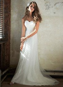 Magnificent is an understatement for this ruched tulle wedding dress. Long and soft, this delicate gown is simply gorgeous.   Strapless bodice and empire waist elongate the figure providing a slimming effect.  Criss-cross ruching on bodice provides a slimming focal point.  Sweep train. Sizes 0-14. Available in Soft White or White (select stores and special order only).  Woman: 9WG3438, 16W-26W (special order only).  Fully lined. Back zip. Dry clean only.  To preserve your wedding dreams…