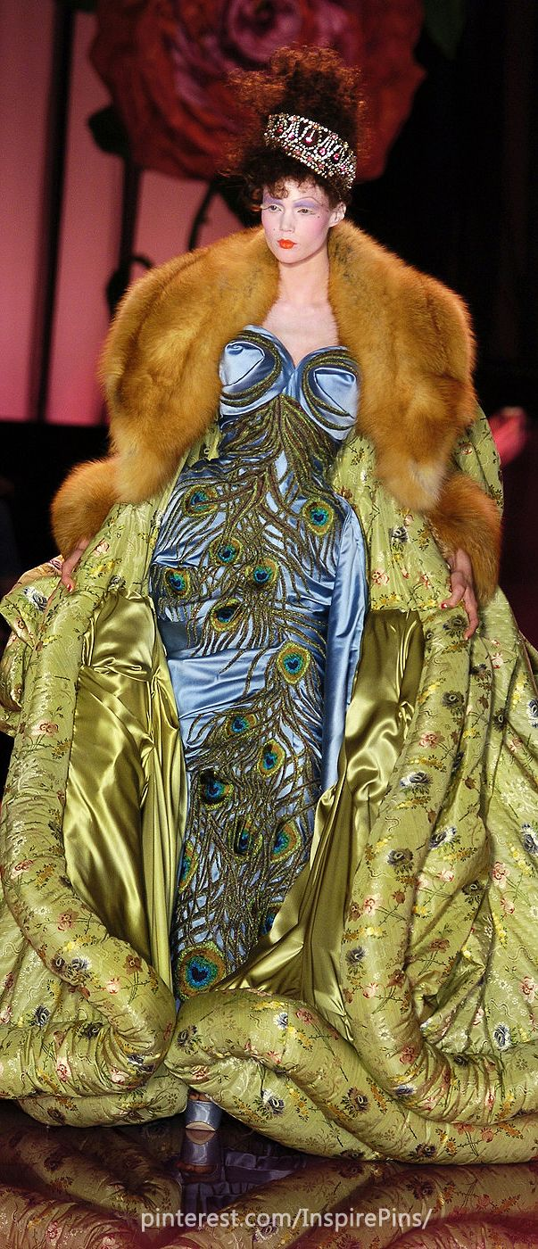 9. Christian Dior F/W 2004. The coat looks very similar to fur trimmed mantels, worn  by rich Italian men.