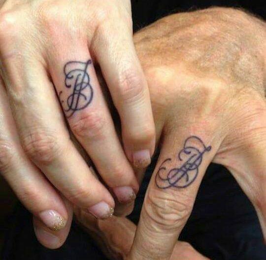 Cool ink.... More Tattoo Ideas, Wedding Tattoo, Couple Tattoo, Wedding Ring Tattoos, Wedding Bands, Inked Magazine, Ink Magazines, Wedding Band Tattoo, Wedding Rings Tattoo Wedding Ring Tattoos - Inked Magazine Wedding tattoo