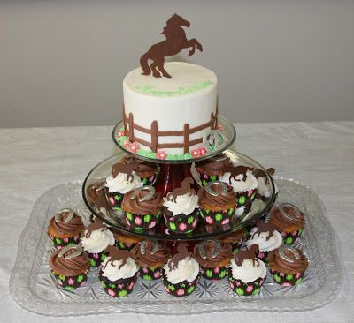 I love this horse birthday cake with cupcakes.