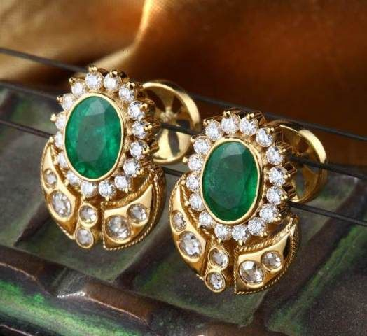Gehna showcasing Emerald and diamond ear studs with a touch of rose cut diamonds handcrafted in 18k gold earrings online in Chennai.