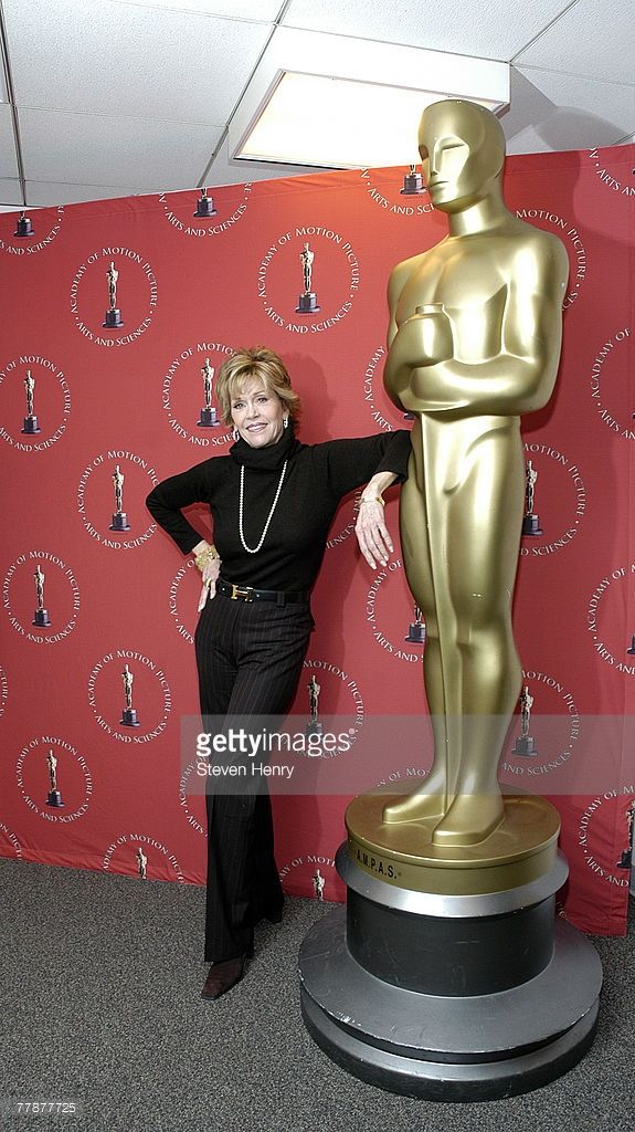 Actress Jane Fonda poses with a larger-than-life replica of the Oscar award at the Monday Nights With Oscars 'Coming Home' 30th Anniversary Screening at The Academy Theatre Lighthouse International on November 12, 2007 in New York City.