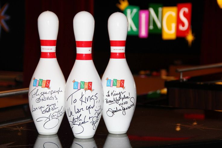 Garth Brooks and Trisha Yearwood autographed these bowling pins at Kings in Rosemont.