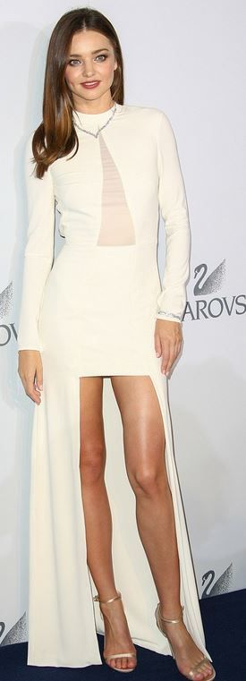 Who made Miranda Kerr's white gown and jewelry?