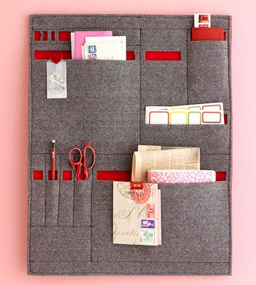 Mail in the Pocket     Sewers should stitch this solution. Create a fabric mail sorter and hang it in a convenient spot. The version shown here was tailored for out-going letters. Adapt it for incoming mail by including big slots for envelopes and small slots for a letter opener and a box cutter (for packages).