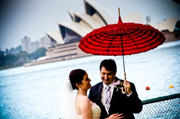 Weddings bring out the best in grooms. Shielding his bride with a parasol