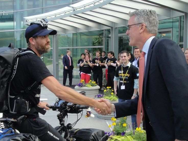 Max shaking hands with the President of SAP in North America at SAP Headquarters in Newton Square.