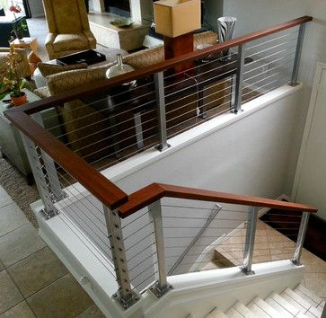 Interior Cable Railing Systems - Silver posts with hardwood top railings and stainless steel cable---Photo Luke Marshall