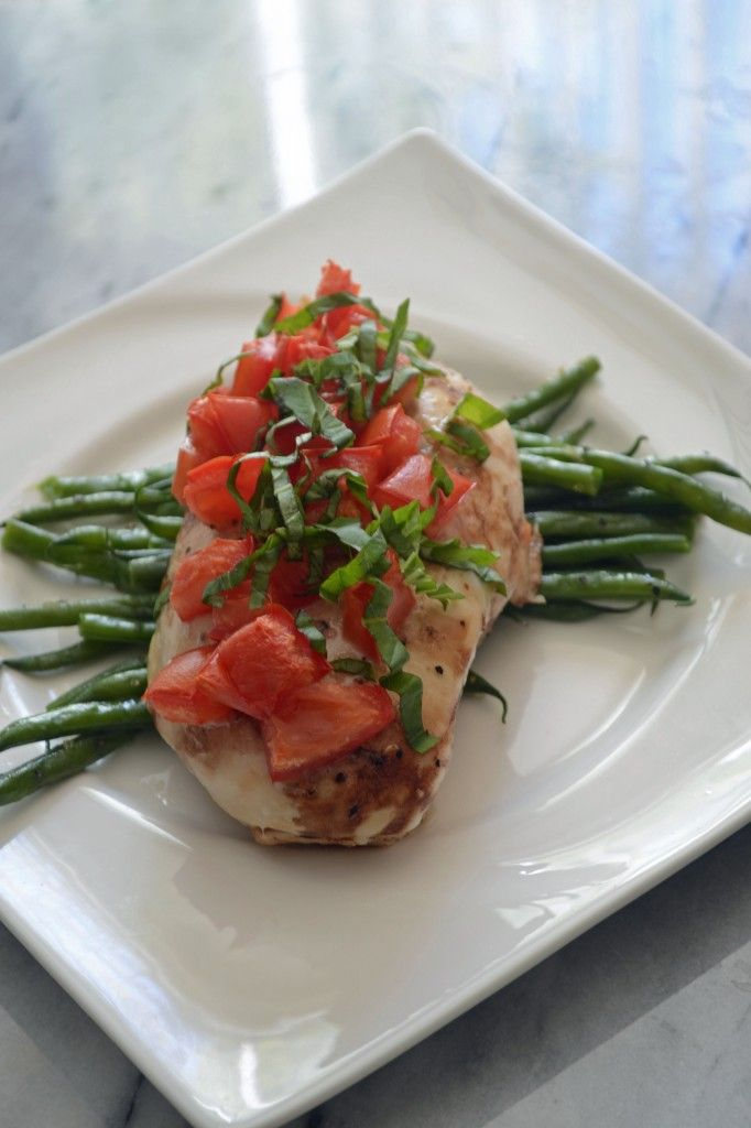 Baked Bruschetta Chicken with tomatoes, garlic, and basil -- quick and simple for Phase 1 (without oil) or Phase 3.