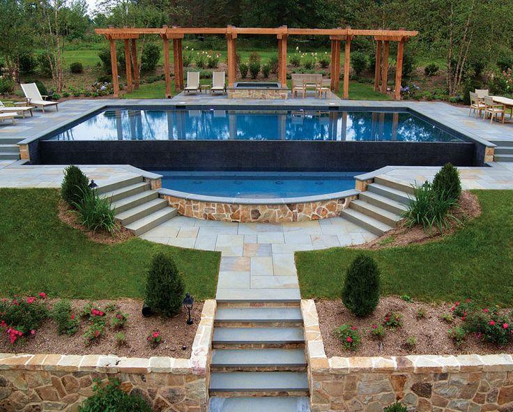 This rectangular infinity pool with a separate raised spa and pergola creates relaxing outdoor retreat.  NESPA 2013 award winner; B & B Pool and Spa Center, Chestnut Ridge, NJ  http://www.poolspaoutdoor.com/photos/2013-nespa-award-winning-pools.aspx