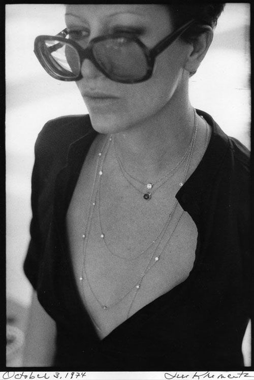 Elsa Peretti: big shades, short hair, several necklaces