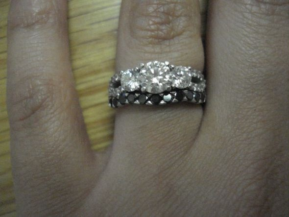 or maybe a band like this one that curves in the middle where your main stone would sit