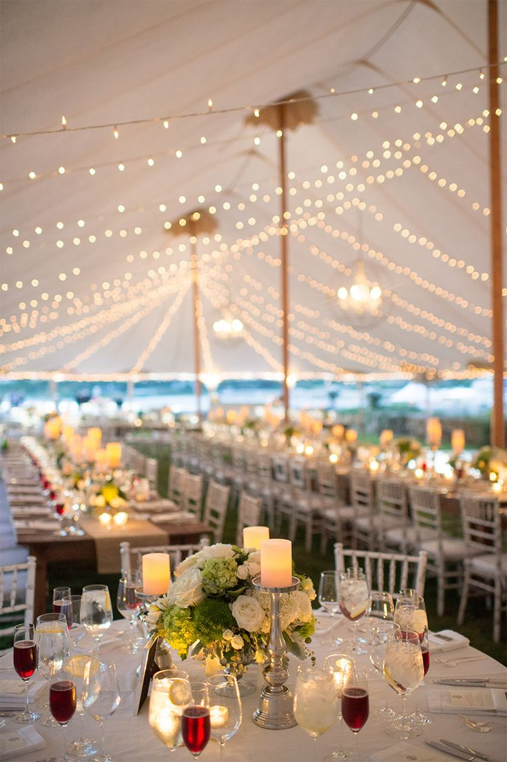 Tented Wedding with al fresco lighting and lots of candles! See the wedding on SMP:  http://www.StyleMePretty.com/2014/02/04/elegant-newport-estate-wedding/ Jenny Moloney Photography