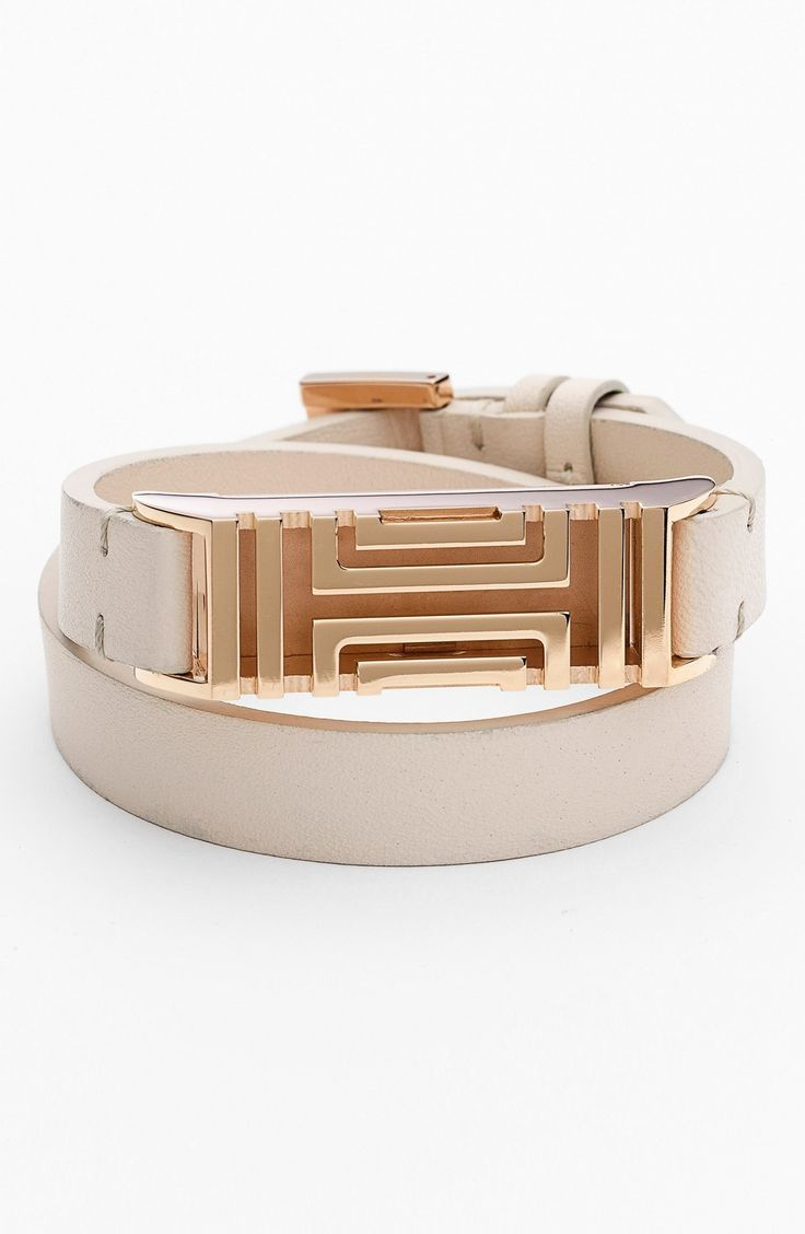 Monitoring fitness and sleep patterns in style is easy with this rose gold Tory Burch bracelet that is designed to subtly hold a Fitbit Flex tracker.